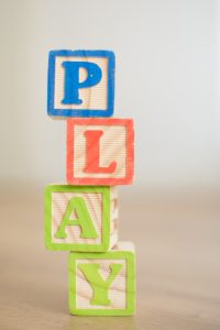 """Wooden blocks stacked spelling """"PLAY"""". Wooden blocks are STEM Toys and great for play schemas."""