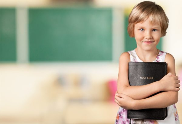 Child holding Bible