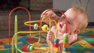 Baby playing with bead toy