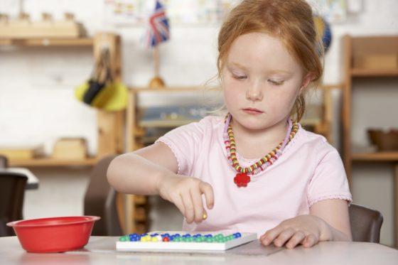 Child in Montessori setting (Montessori vs Daycare)