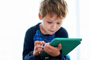 montessori taught online child looking at what learning app is best.