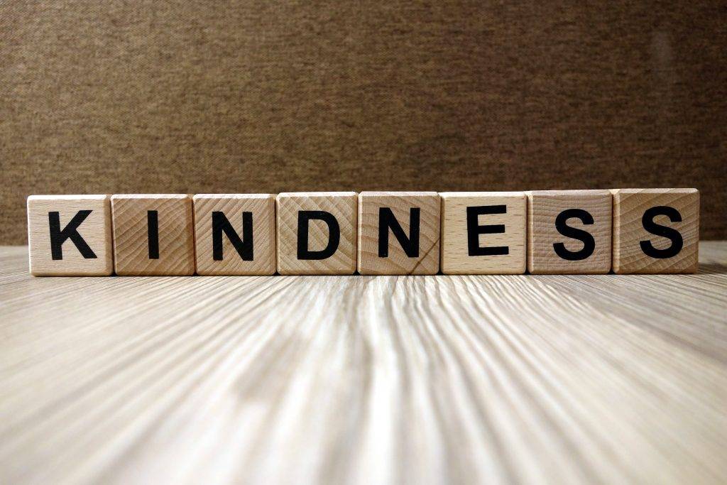 How to teach grace and courtesy, image of scrabble tiles spelling kindness.