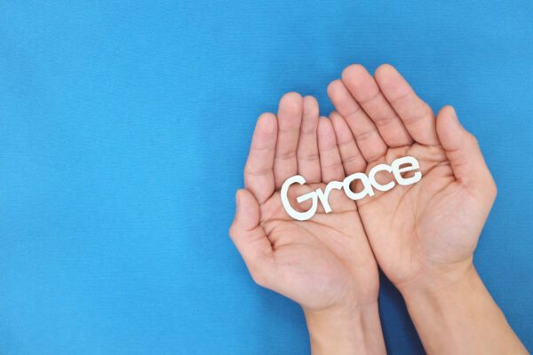 image of a hand holding the word grace to represent grace and courtesy.