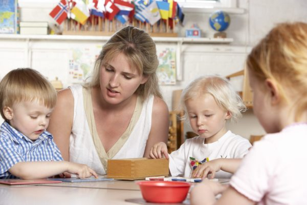 Montessori teacher, giving a presentation