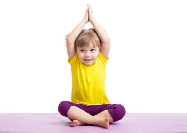 Child in Yoga pose. A heavy work exercise.