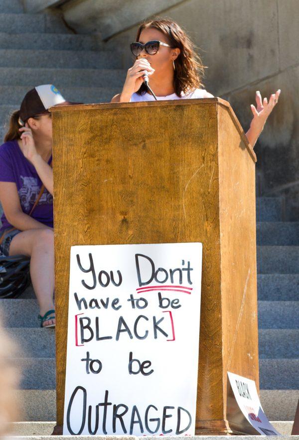 speaker at podium at black lives matter protest