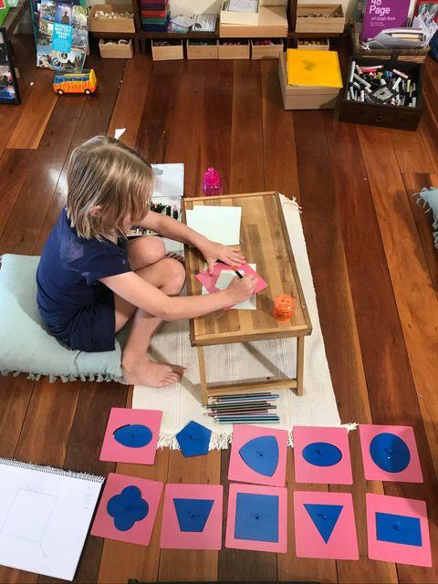 child using Montessori metal insets