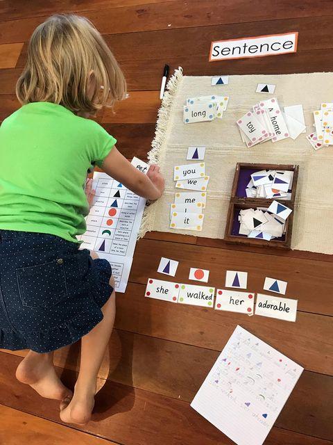 child working on Montessori work mat