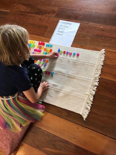 special needs child using Montessori movable alphabet