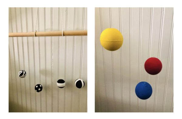 DIY Montessori baby mobile: black and white balls on left and image of yellow, red and blue on right.