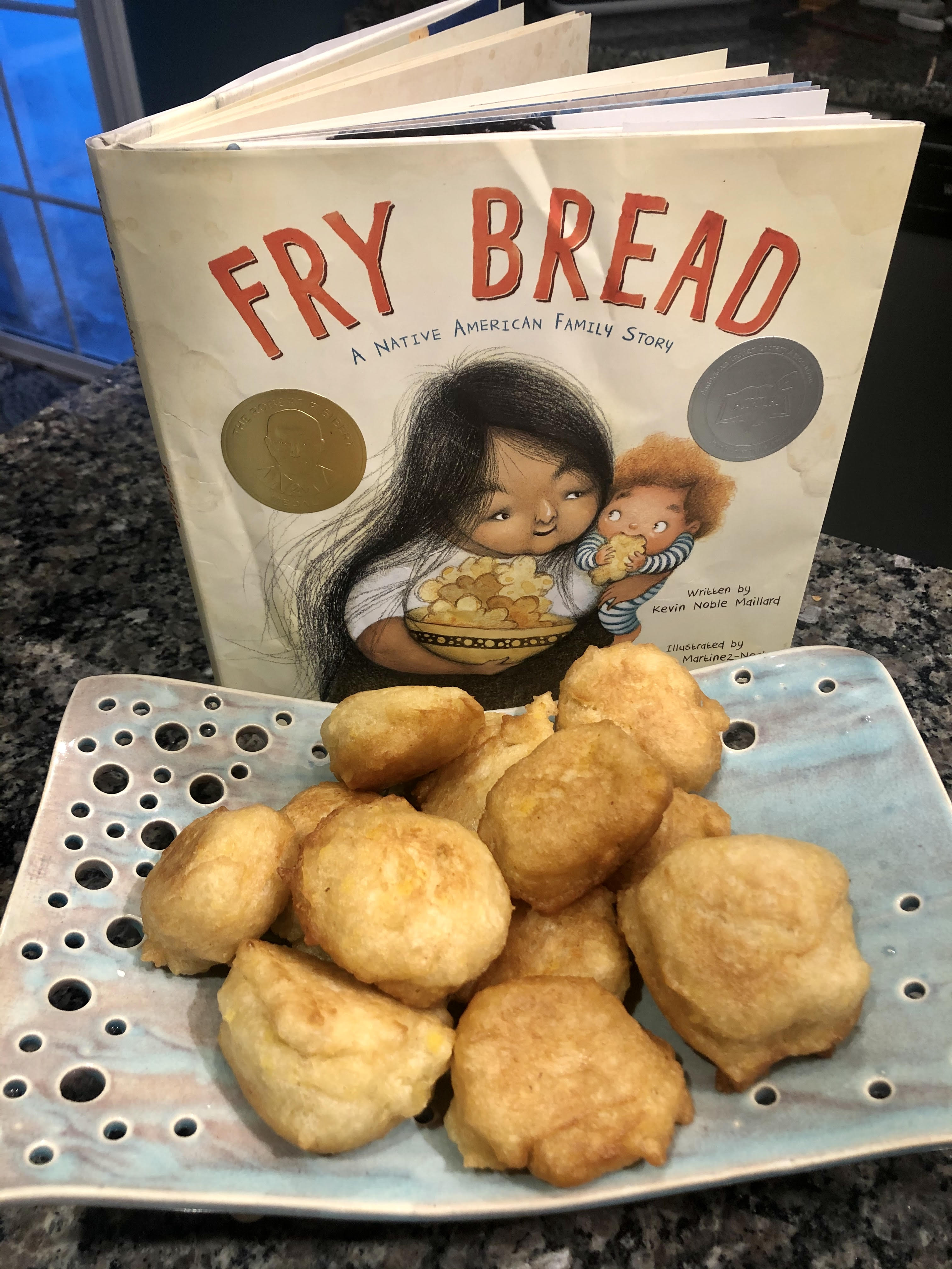 cooked fry bread on tray in front of Fry bread children's book
