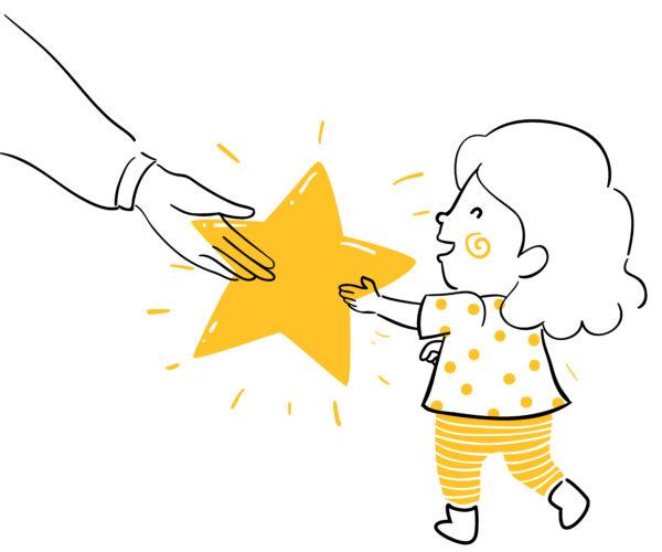 child getting gold star as reward.
