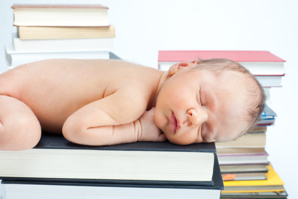 Montessori baby on books.