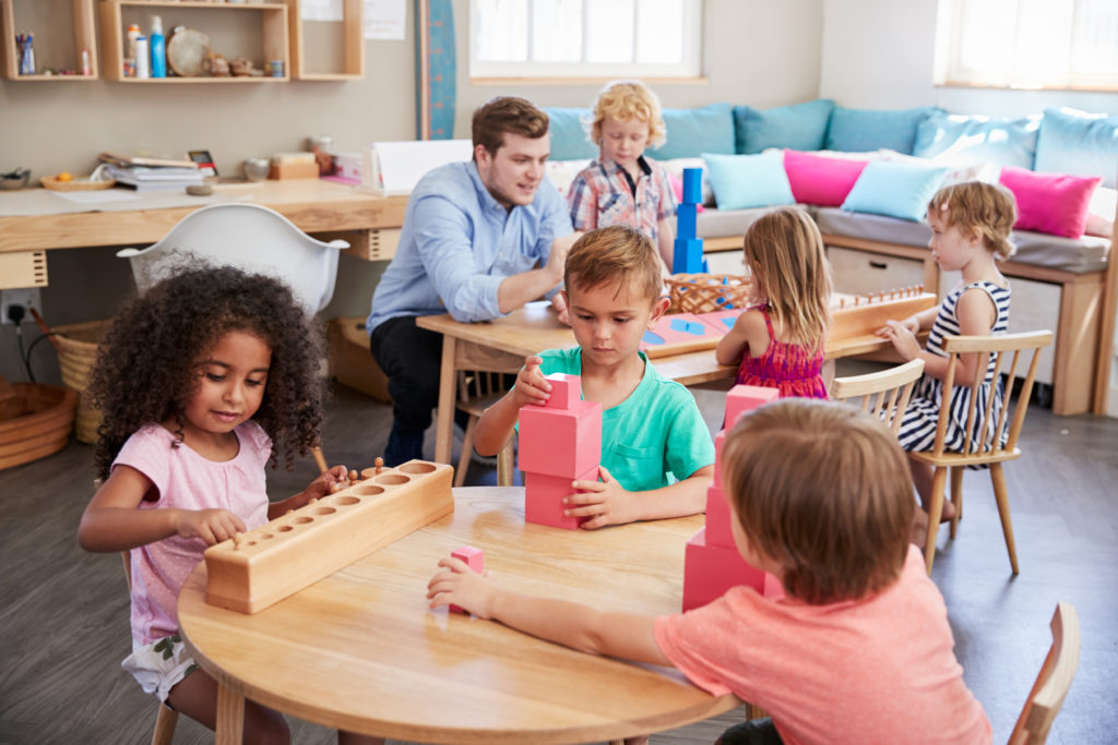 teacher with students showing neurodiversity in the montessori classroom