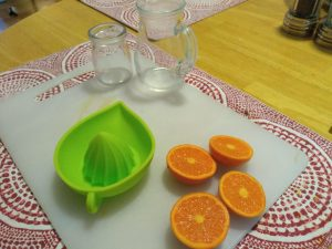 oranges and glasses for making hand squeezed juice.