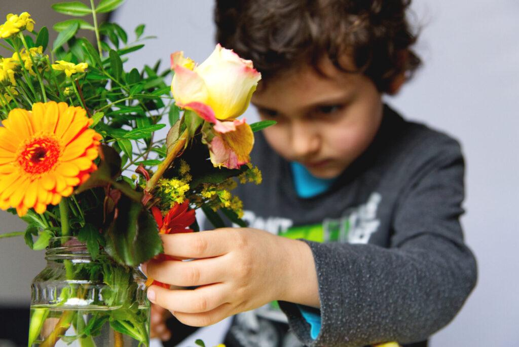 child doing montessori flower arranging activity.
