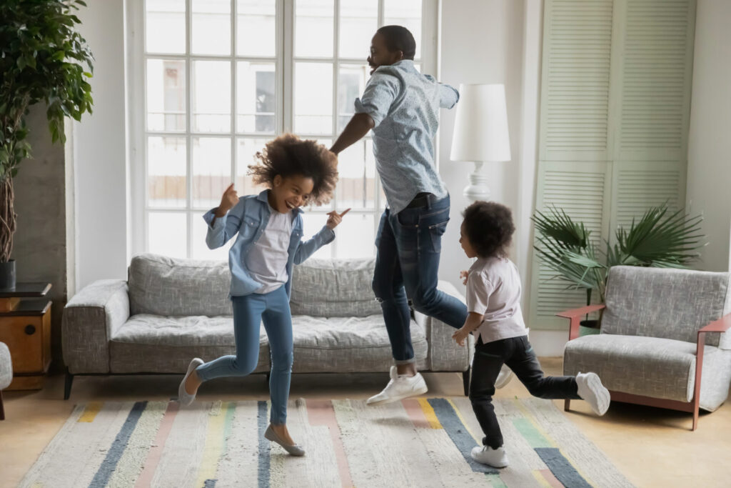 parent dancing with children as a music and movement activity.