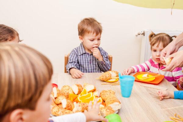 children gathered around small table.