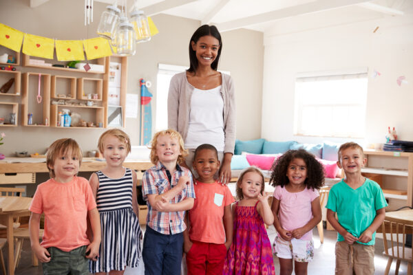 Good montessori teacher standing with class.