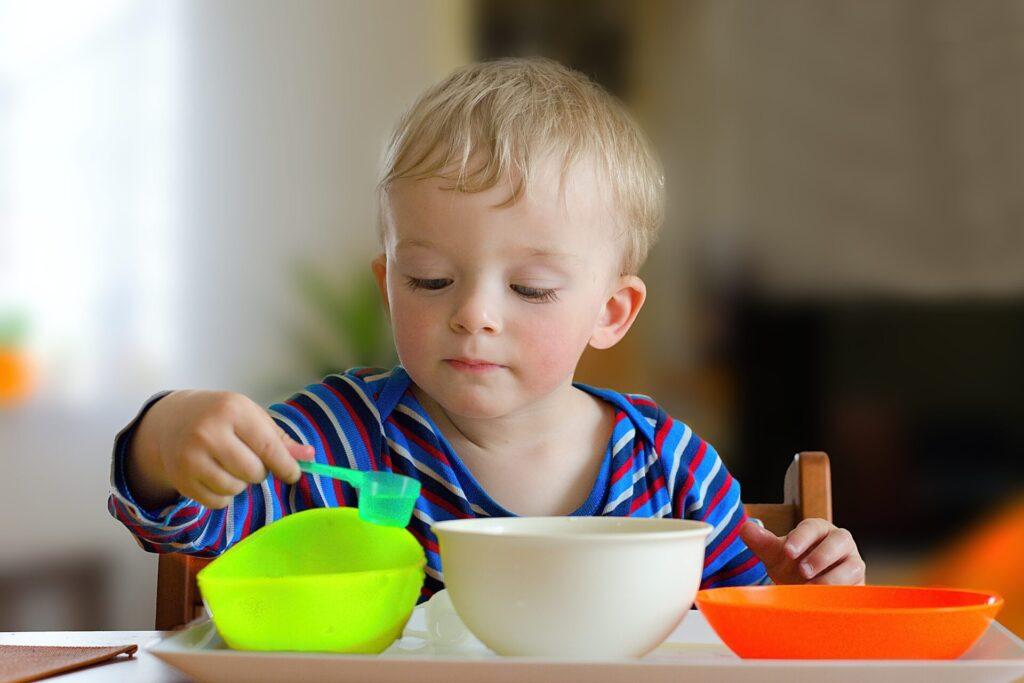child scooping.