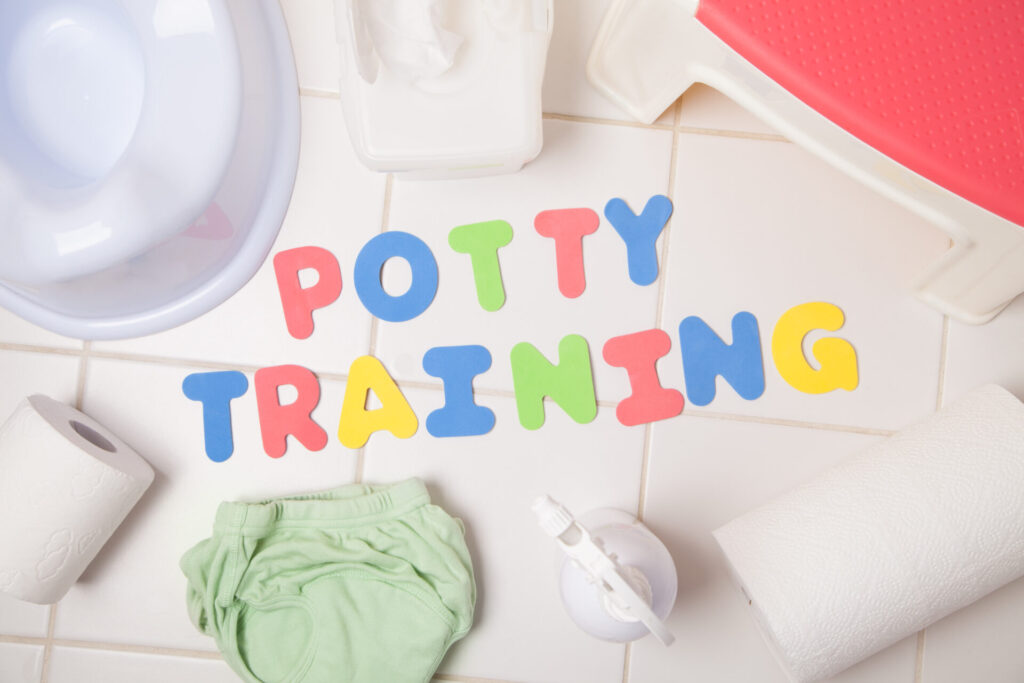 potty training letter near diaper and potty seat.