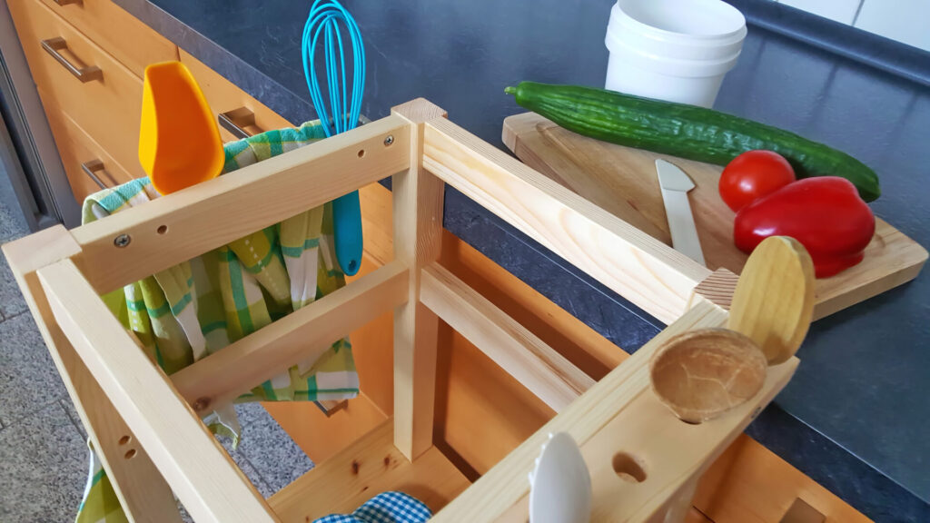 montessori learning tower and utensils.