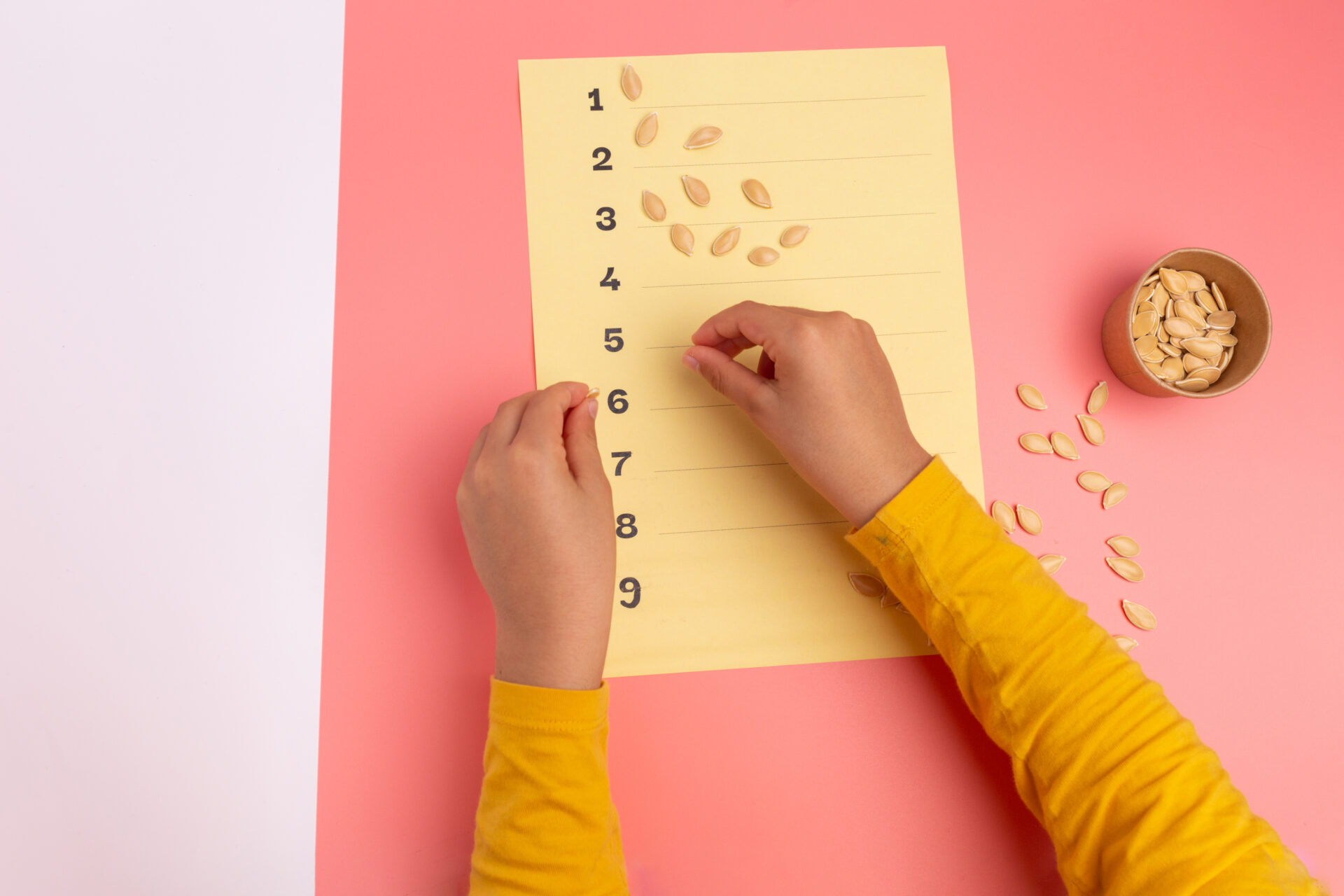 child using sunflower seeds for math activity.
