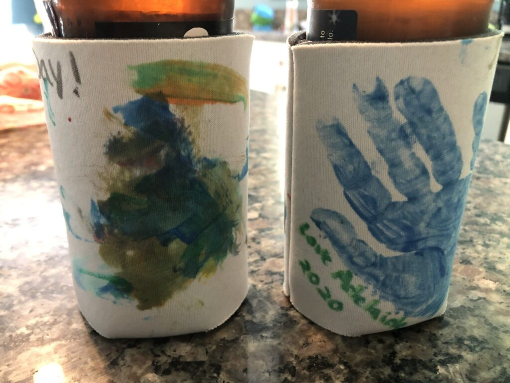 father's day craft drink koozie painted by toddler with handprint.