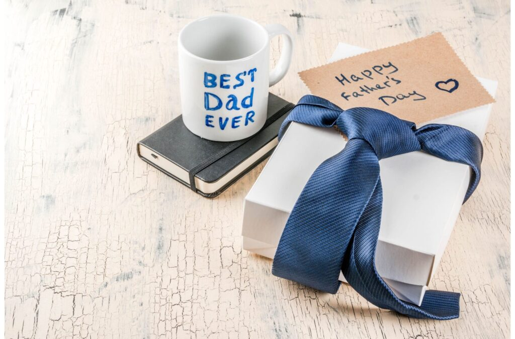 father's day crafts for toddlers and preschoolers image of gift box, wrapped in blue tie and best dad ever mug.