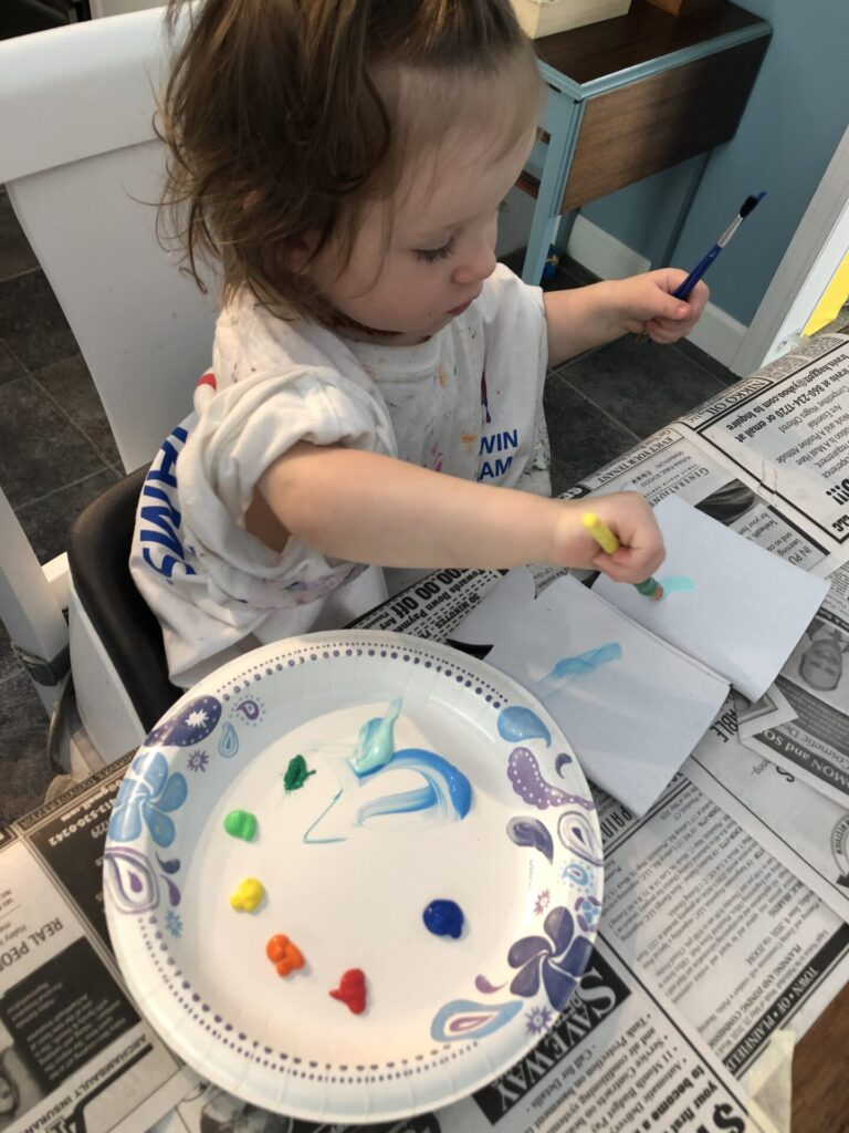 toddler painting drink koozies for father's day craft gift.