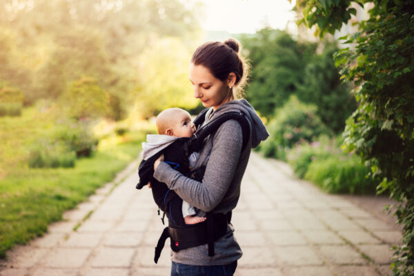 image of mother with baby in carrier.