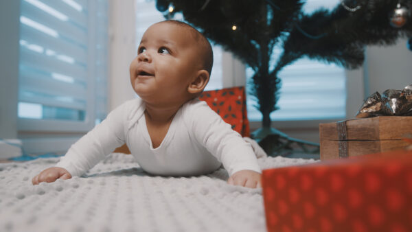 image of happy baby during tummy time.