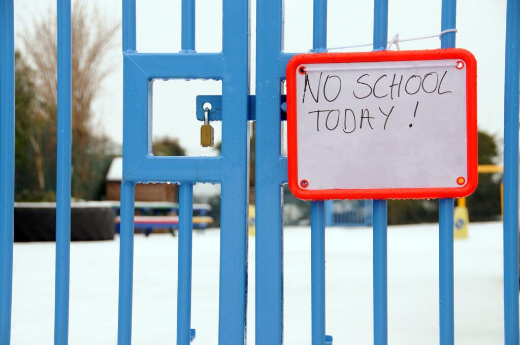 image of locked montessori school gate.
