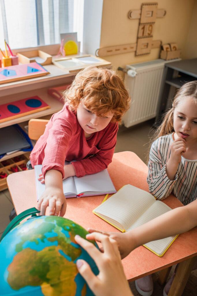 image of children taking part in 3 period lesson in Montessori.