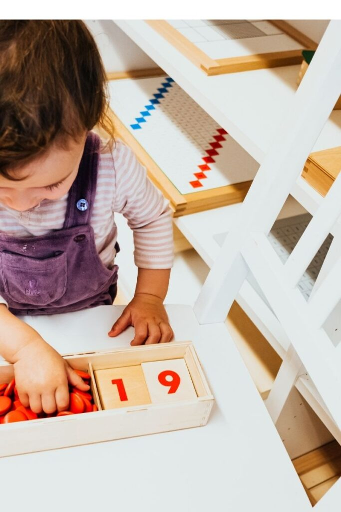 image of child working with Montessori cards and counters.