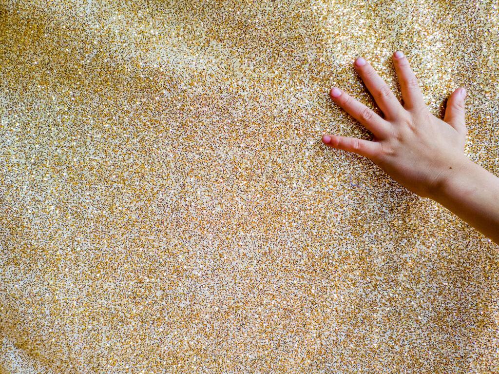 image of a montessori child reaching to touch fabrics.