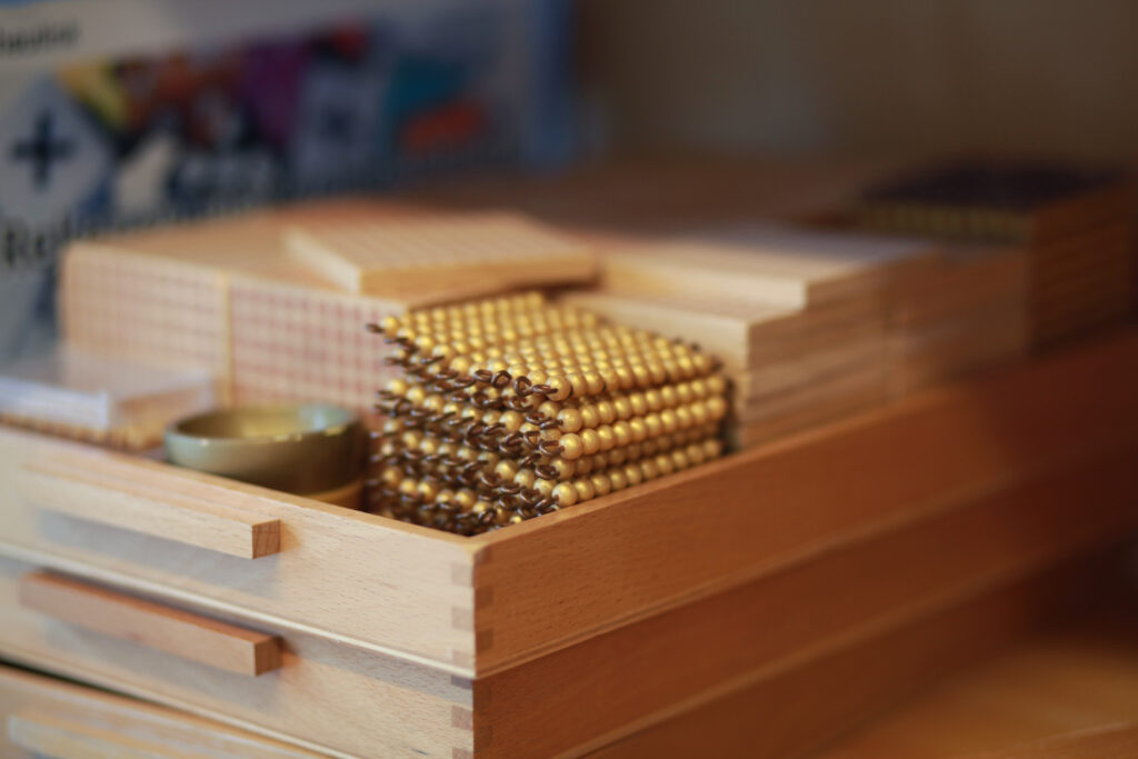 image of Montessori golden bead material, which is used in the change game or exchange game.