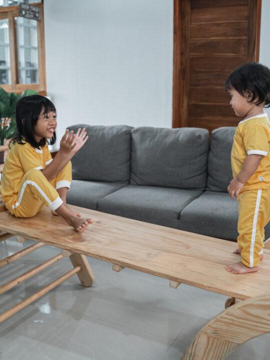 image of 2 children playing on montessori gross motor toys.