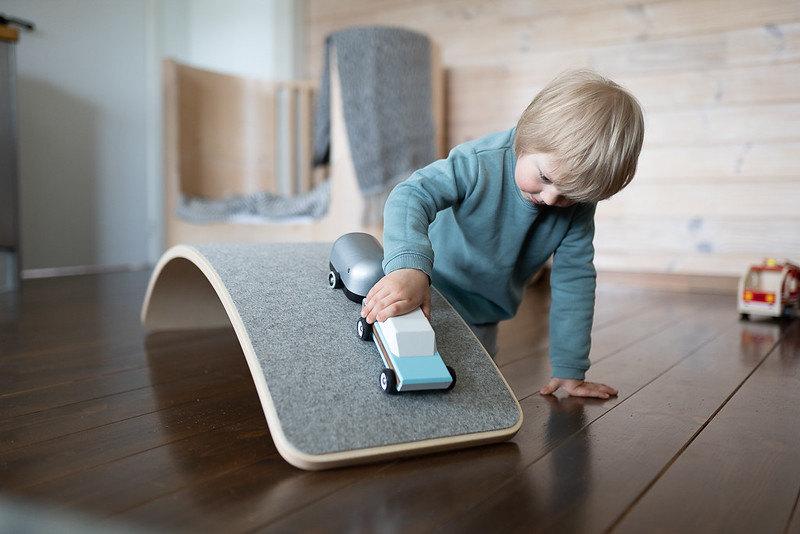 image of child playing with montessori balance boards.