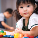 image of a Montessori 3-year-old playing with toys.