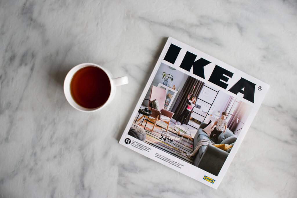 image of cup next to ikea catelog for montessori shopping trip.