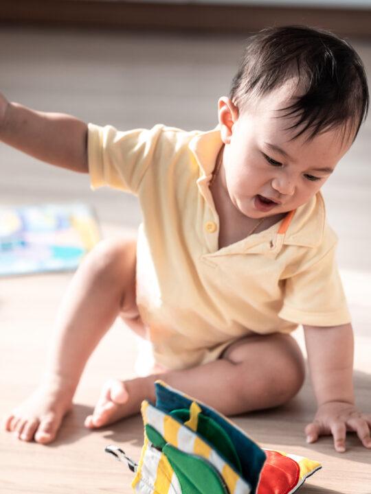 image of toddler throwing toys.