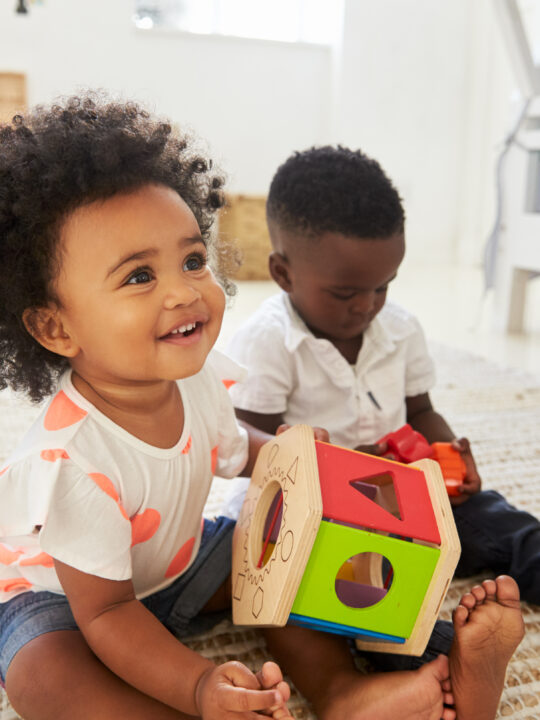 image of children playing with Montessorit toys for 18-month-old.